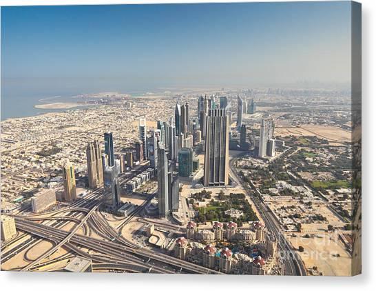 Atmosphere Canvas Print - Dubai Cityscape From Burj Khalifa At by Petr Vorobev