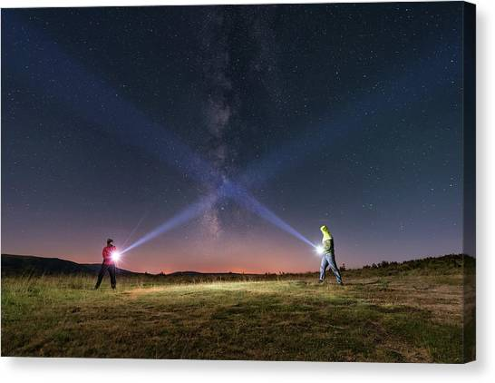Duel Of Light Canvas Print by Carlos Fernandez