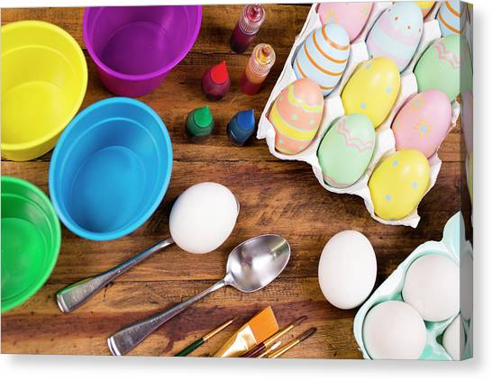 Easter Eggs Being Decorated On Wooden Canvas Print by Fstop123