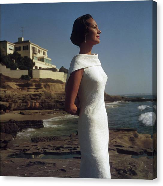 Elegance On The Beach Canvas Print by Slim Aarons
