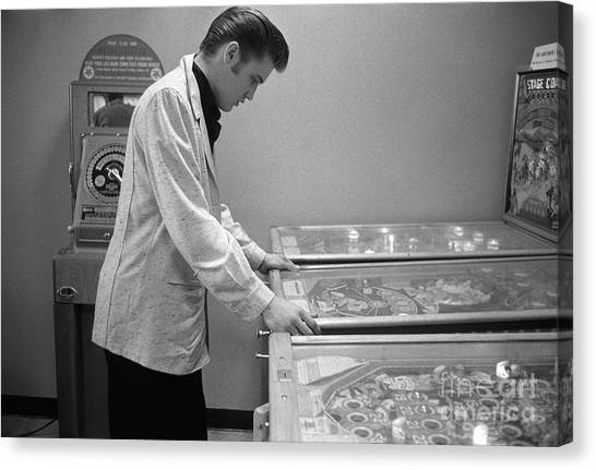 Elvis Canvas Print - Elvis Presley Playing Pinball 1956 by The Harrington Collection