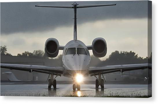 Canvas Print featuring the photograph Embraer 145 by Guy Whiteley