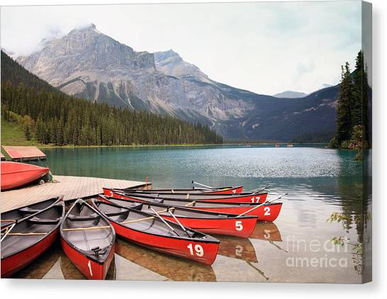 Canoe Canvas Print - Emerald Lake Is One Of The Most Admired by Hdsidesign