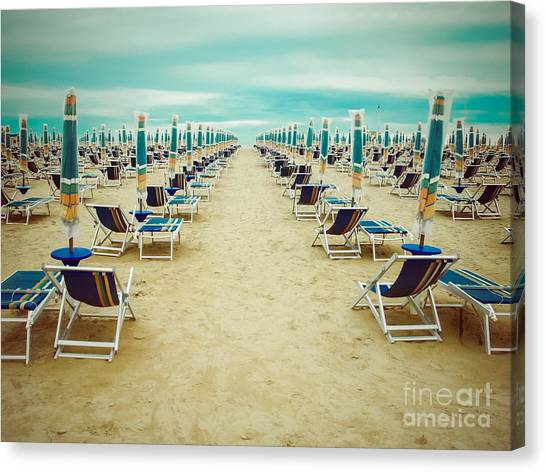 Empty Beach Scenery With Deckchairs And Canvas Print by Anastazzo