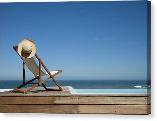 Empty Deck Chair Near Swimming Pool Canvas Print