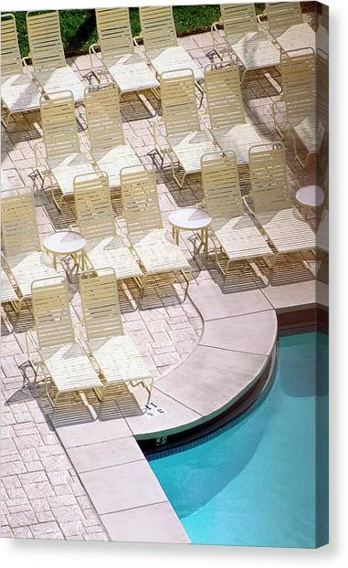 Empty Poolside Chairs At A Holiday Canvas Print by Wesley Hitt
