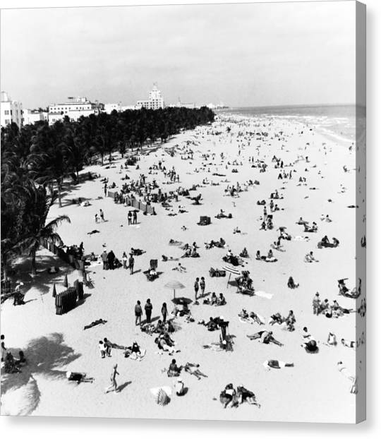 Enjoying Miami Beach Canvas Print by Fpg