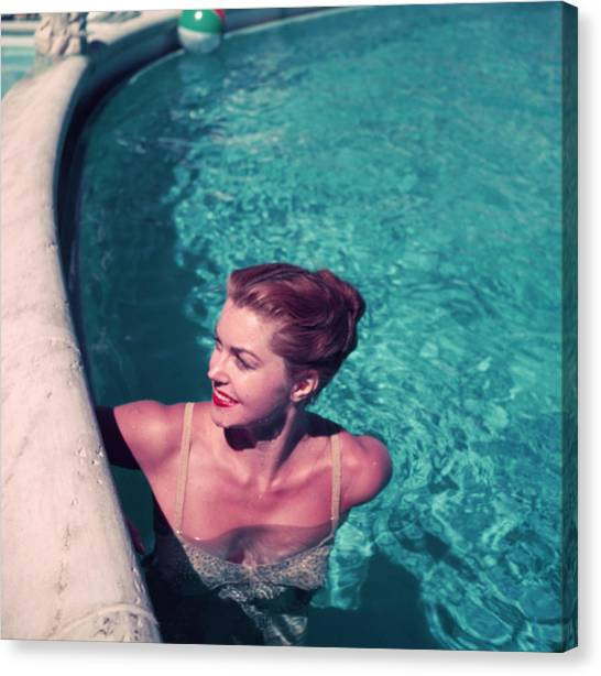 Esther Williams In Pool Canvas Print by Slim Aarons
