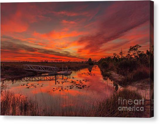 Canvas Print featuring the photograph Explosive Sunset At Pine Glades by Tom Claud