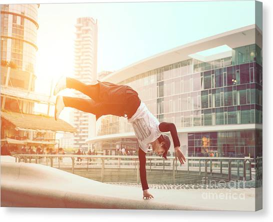Exercising Canvas Print - Extreme Parkour In Business Center by Oneinchpunch