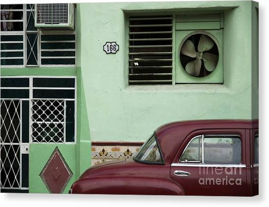 Urban Decay Canvas Print - Facade And Oldtimer In Old Havana by Roxana Gonzalez