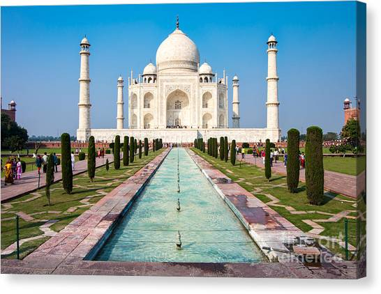 Famous Taj Mahal Mausoleum In In Bright Canvas Print by Mikhail Varentsov