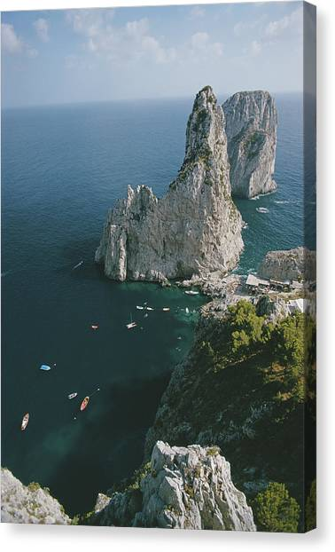 Faraglioni Rocks Canvas Print by Slim Aarons