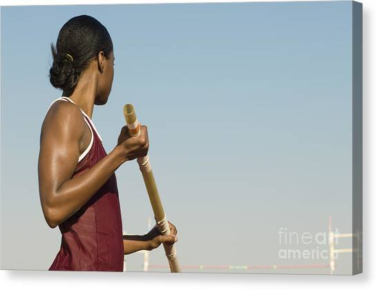 Sports Clothing Canvas Print - Female Athlete Preparing For Pole Jump by Sirtravelalot