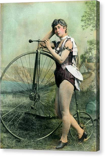 Female Circus Performer With Bicycle Canvas Print by Bettmann