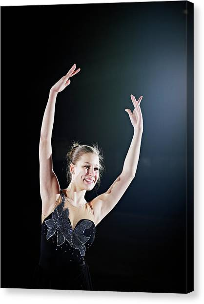 Female Figure Skater Posing With Arms Canvas Print by Thomas Barwick