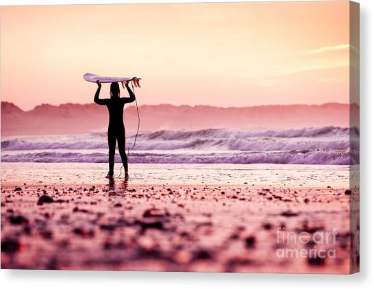 Beauty Canvas Print - Female Surfer On The Beach At The Sunset by Iko