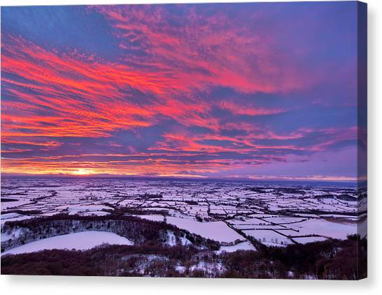 Fiery Sunset Over A Snow Covered Canvas Print