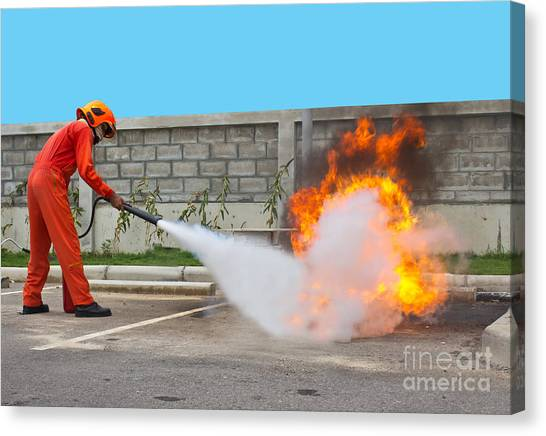 Fighting Fire During Training Canvas Print by Yutthaphong