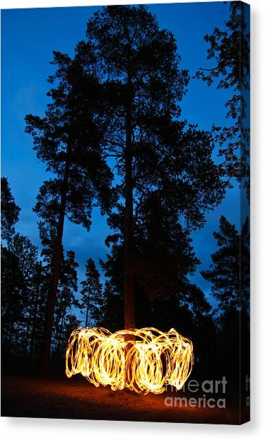 Performing Canvas Print - Fire Spinning At Night In Forest by Juhku