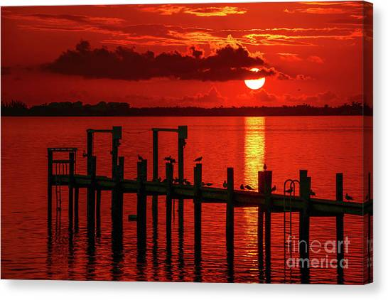 Canvas Print featuring the photograph Fireball And Pier Sunrise by Tom Claud