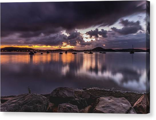 First Light With Heavy Rain Clouds On The Bay Canvas Print