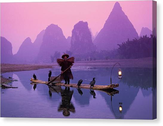 Fisherman On Bamboo Raft With Canvas Print