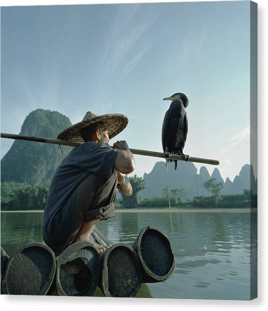 Fisherman Sitting On Bamboo Raft With Canvas Print