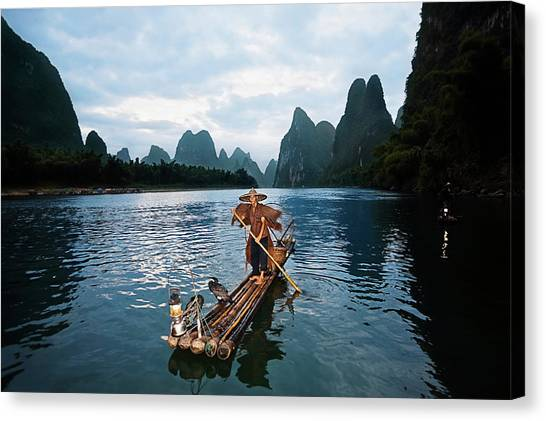 Fisherman Standing On A Wooden Raft In Canvas Print