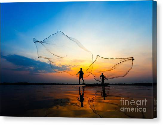 Fishermans In Action When Fishing At Canvas Print by Twstock