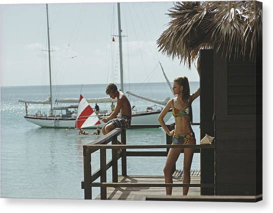 Fishing On Honeymoon Porch Canvas Print by Slim Aarons