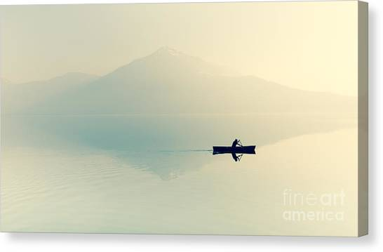 Fog Over The Lake. Silhouette Of Canvas Print by Maryna Patzen