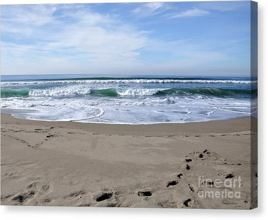 Footprints By The Sea Canvas Print
