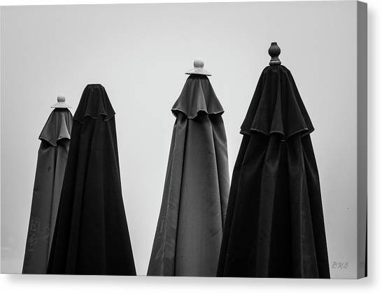 Canvas Print featuring the photograph Four Umbrellas Bw by David Gordon