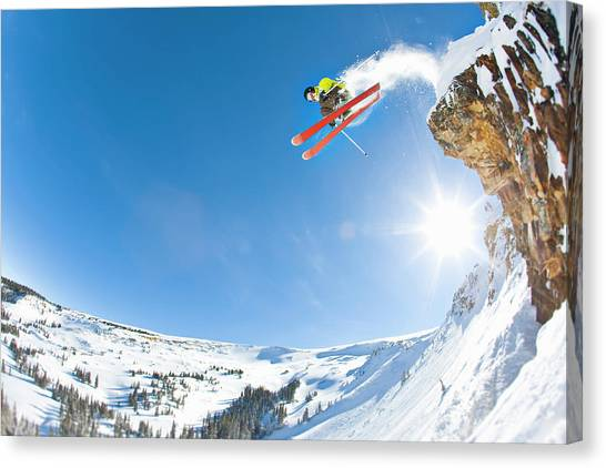 Sky Canvas Print - Freestyle Skier Jumping Off Cliff by Tyler Stableford