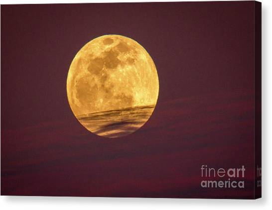 Full Moon Above Clouds Canvas Print