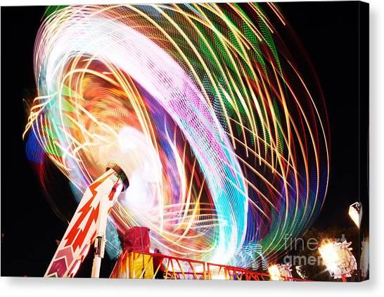 Fun Fair, Long Exposure. Colourful Canvas Print by David Mg