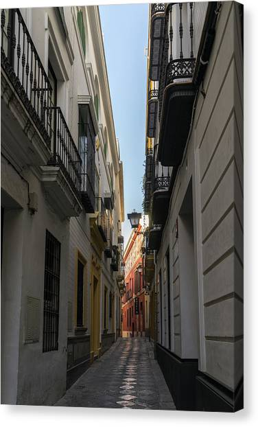 7c72fc9ad Tight Canvas Print - Gallivanting Around Seville Is Pure Charm - Narrow  Street Morning Glow by