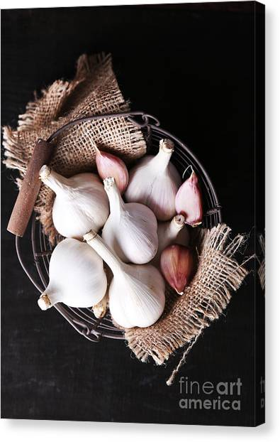 Basket Canvas Print - Garlic In Basket On Black Wooden by Africa Studio