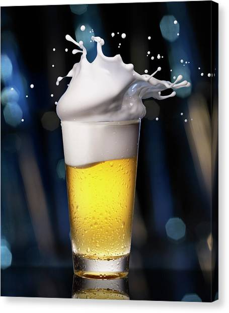 Glass Of Beer With Splashing Foam Canvas Print