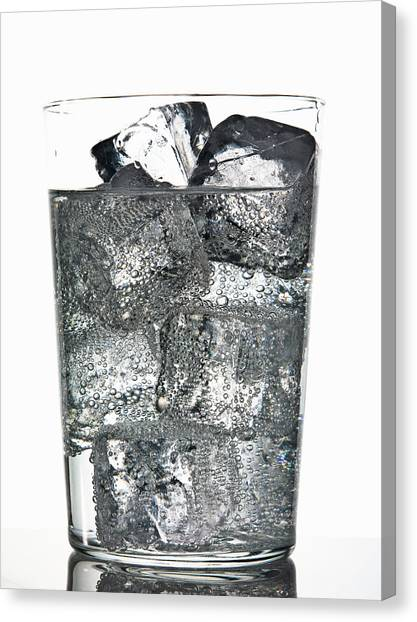 Glass Of Ice Cubes In Fizzy Drink Canvas Print by Walter Zerla