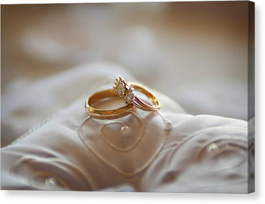 Gold Wedding Rings On A Pillow Canvas Print by Driendl Group