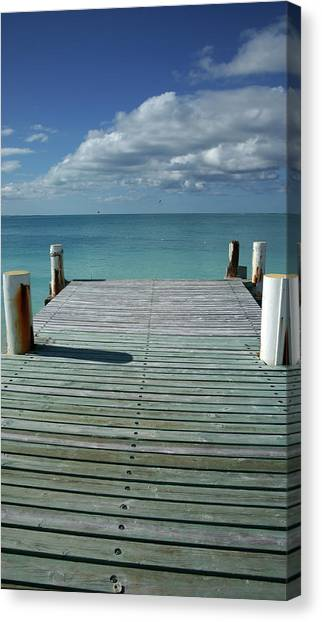 Grace Bay Wooden Pier On The Island Of Canvas Print by Greg Newington