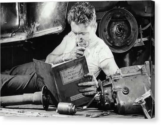 Greasy Mechanic On Garage Floor, Manual Canvas Print