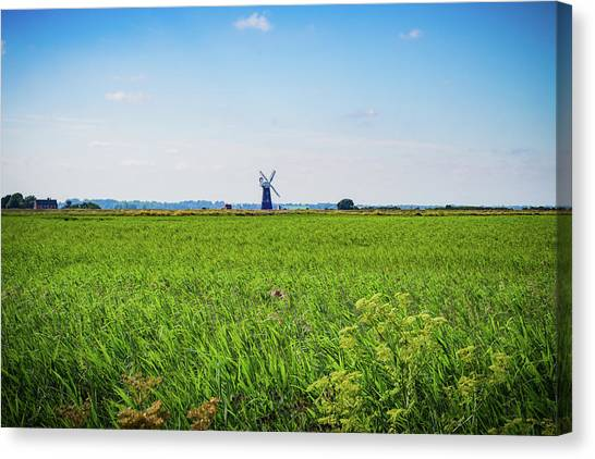 Canvas Print featuring the photograph Green Grass Field With Windmill On Horizon by Scott Lyons