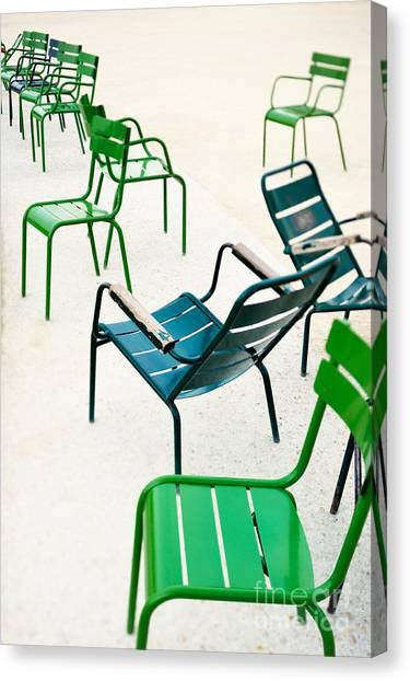 Parisian Canvas Print - Green Metallic Chairs In The City Park by Anatoli Styf