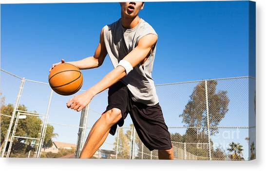 Exercising Canvas Print - Handsome Male Playing Basketball Outdoor by Pkpix