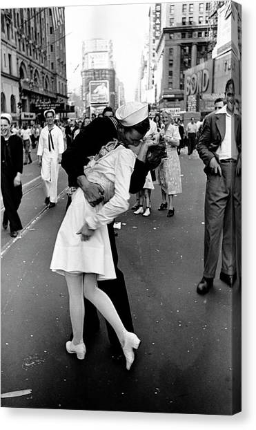 Happy Sailor Kissing Nurse In Times Canvas Print by Alfred Eisenstaedt