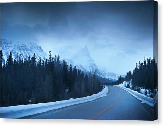 Highway Through The Canadian Rockies Canvas Print by Kjell Linder