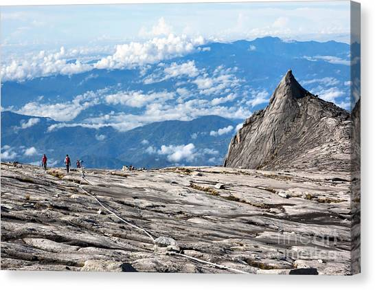 Mountain Climbing Canvas Print - Hikers At The Top Of Mount Kinabalu In by R.m. Nunes